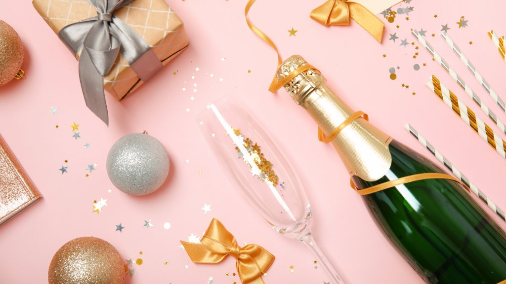 Creative flat lay composition with bottle of champagne and party accessories on color background - Image.