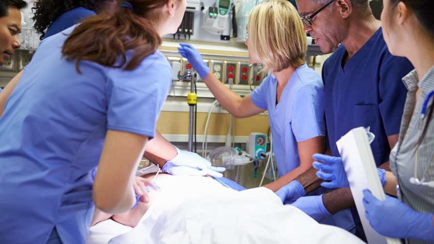 nurses and docors helping person in emergency room
