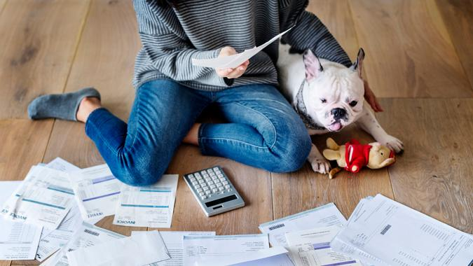 Woman managing the debt.