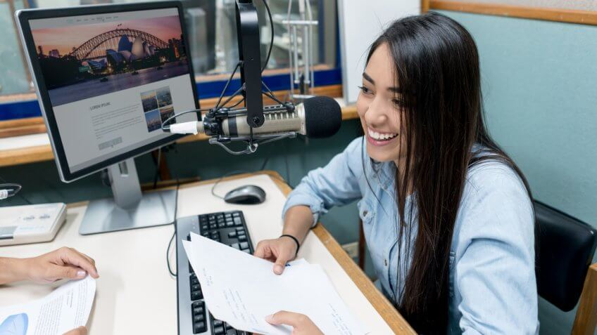 Female student broadcasting from a radio station
