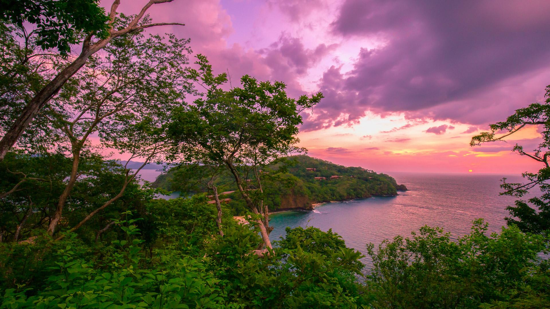 A shot of beautiful sunset over Coast Rica coastline.