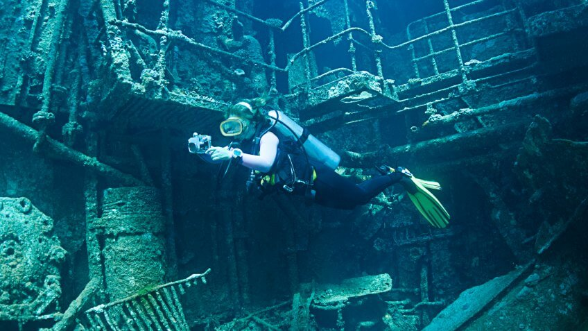 Diver exploring the interior of a shipwreck called Chrisoula K in Abu Nuhas, Red Sea.