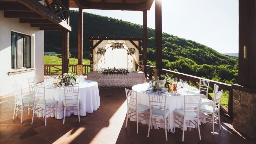 Beautiful decorated wedding ceremony outdoor with mountain view.