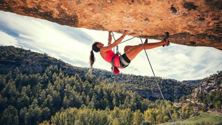 Woman rock climbing in Margalef Catalonia Spain.