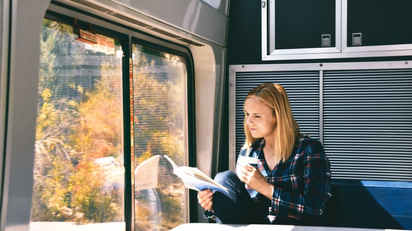 woman reading on Amtrak train