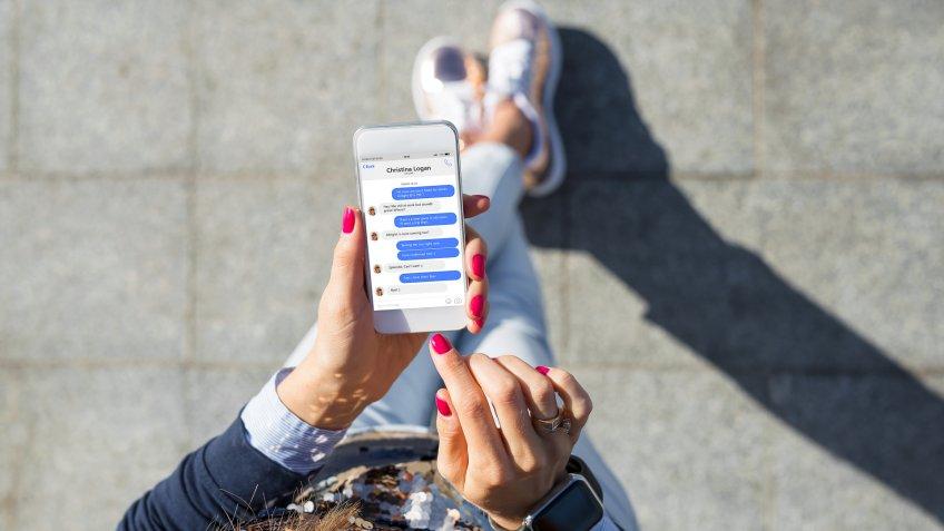 woman using Facebook Messenger app