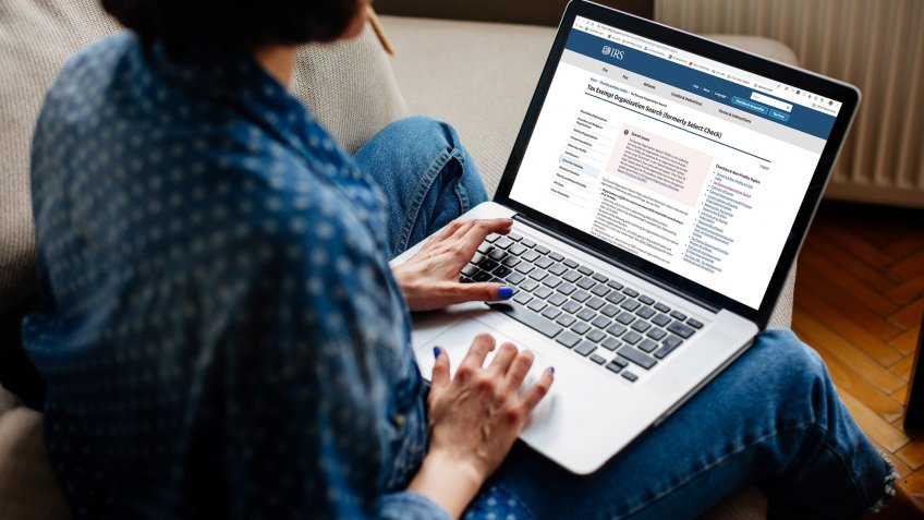 woman using laptop with IRS website