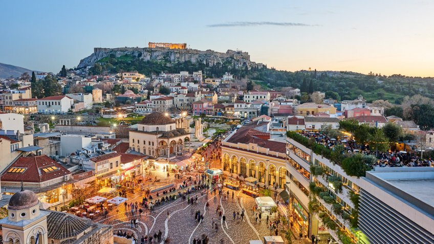 Athens, Greece - February 13, 2016: Aerial view of Athens at sunset with an illuminated Acropolis in the background.