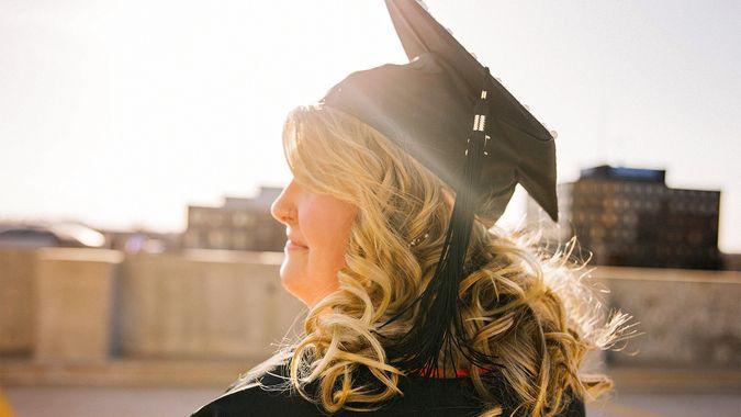 College graduate standing in sunlight