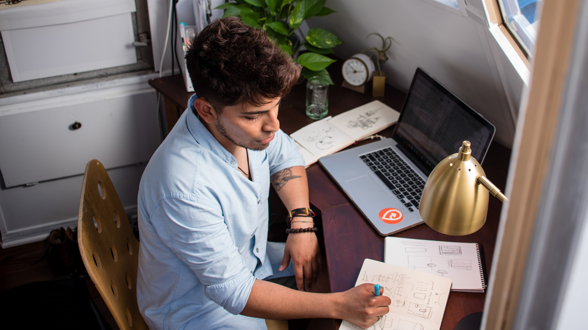freelancer working at his desk at home