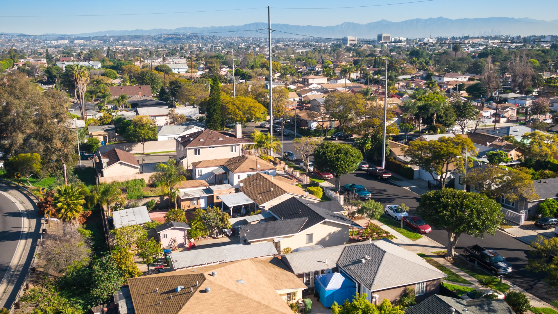 Photo of a Residential Neighborhood with Houses and Rooftops in the Inglewood area of Los Angeles, California, USA, shot from above.