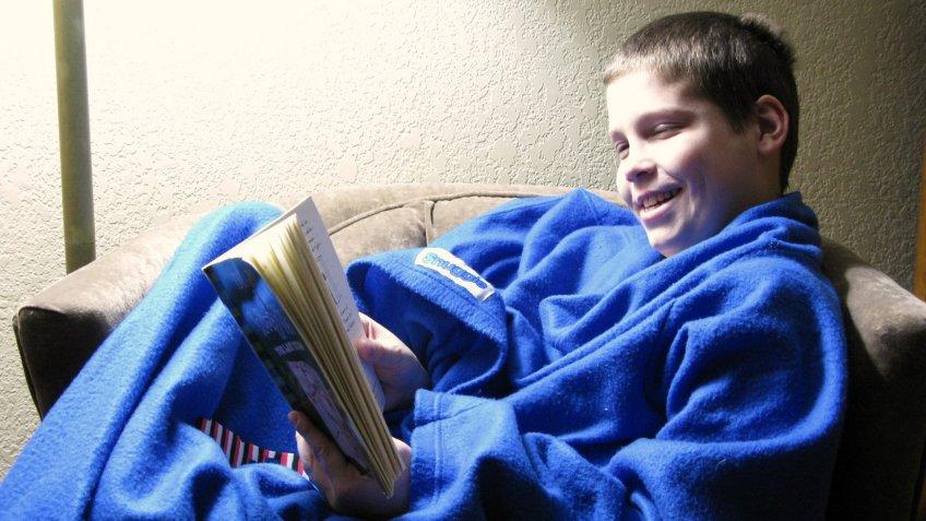 Kid wearing Snuggie blanket