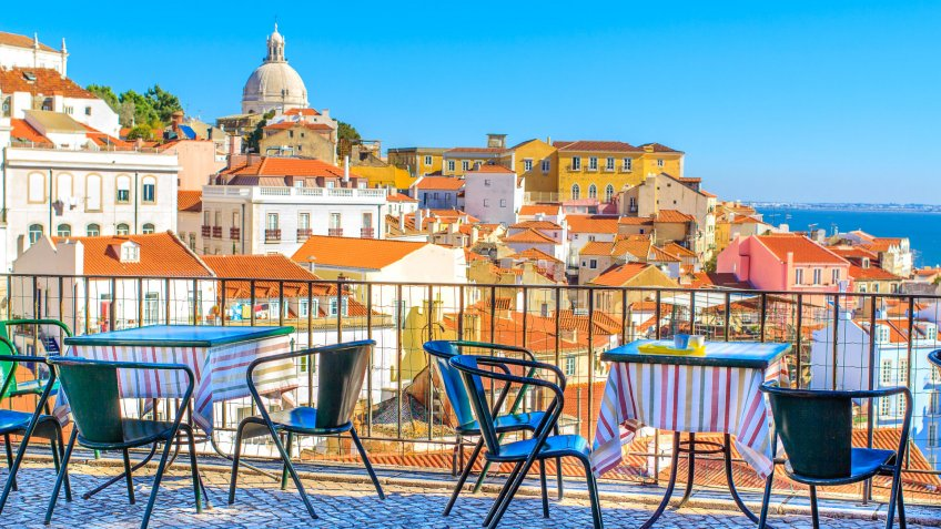 Open café tarrace with breathtaking view at Alfama - historical city-center of Lisbon, Portugal.