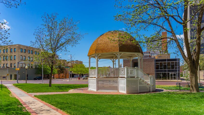 Spring begins in the downtown Lubbock with a white gazebo and walkway ,Texas.