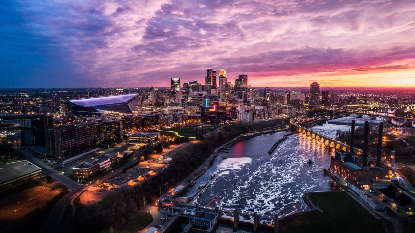 Springtime Sunset over Downtown Minneapolis, St Anthony Falls and Mississippi River - Aerial Shot.
