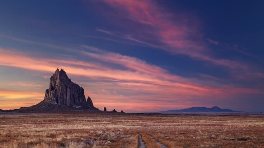 Shiprock, the great volcanic rock mountain in desert plane of New Mexico, USA.