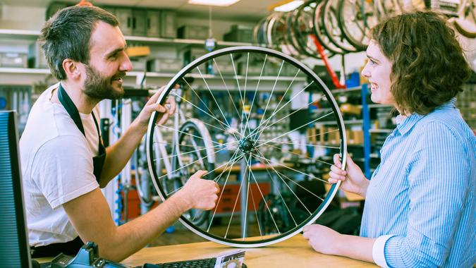 customer and dealer in bicycle shop - purchase and repair of bicycles - customer service.