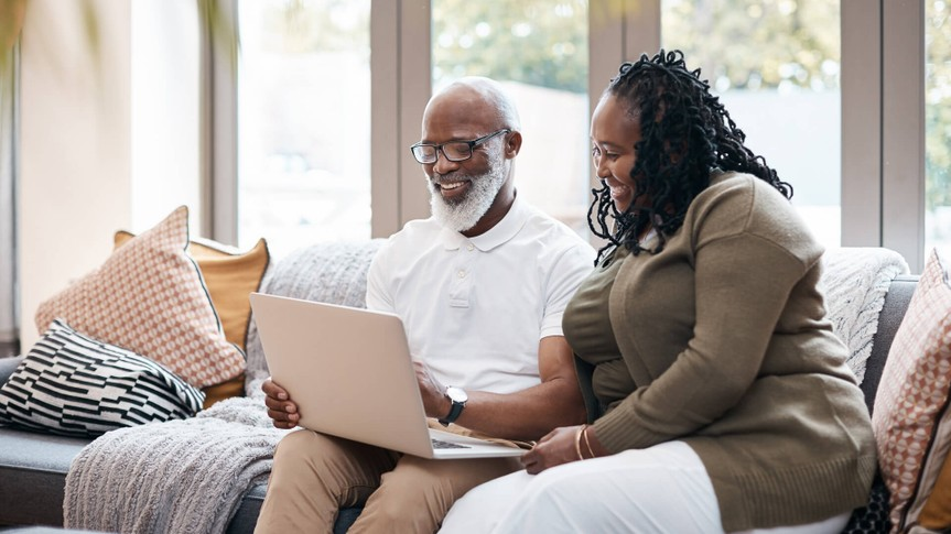 Shot of a mature couple using a laptop together at home.