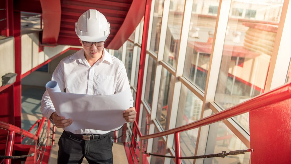 Engineer or Architect checking architectural drawing