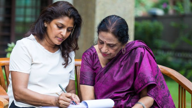 Women completing the last will and testament.