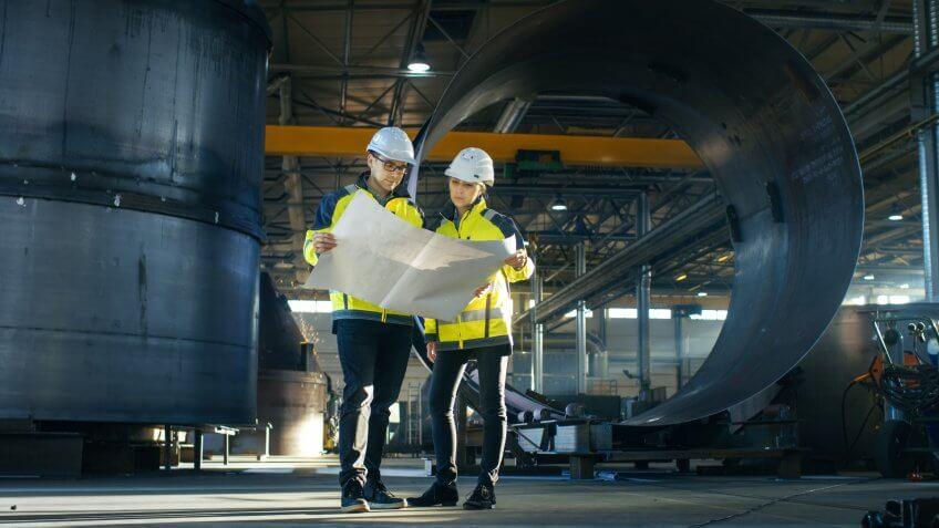 industrial engineers reviewing plans