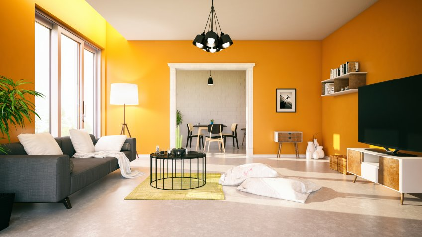 Modern living room with orange walls.
