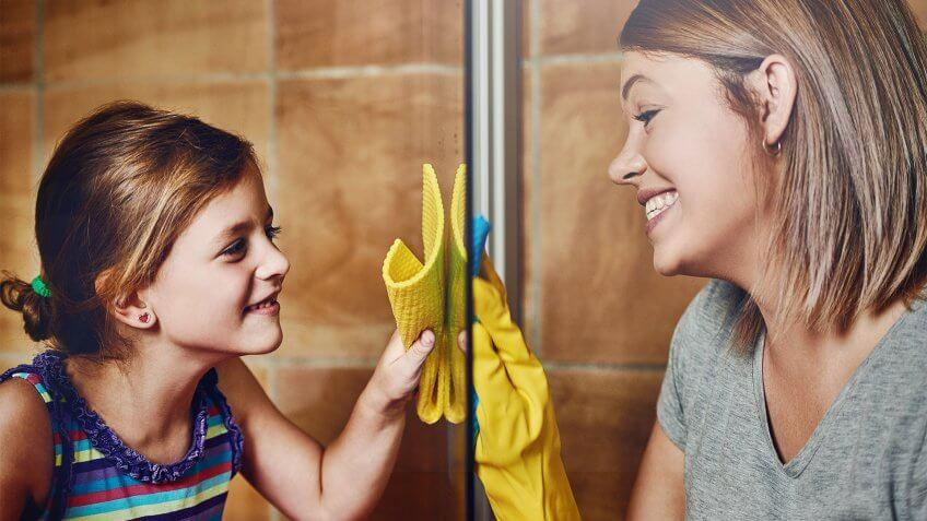 Cropped shot of a mother and her little daughter cleaning a bathroom together at home.
