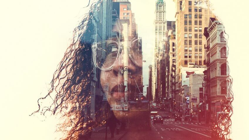 profile of a woman's head, a New York City skyline double exposed with the image.