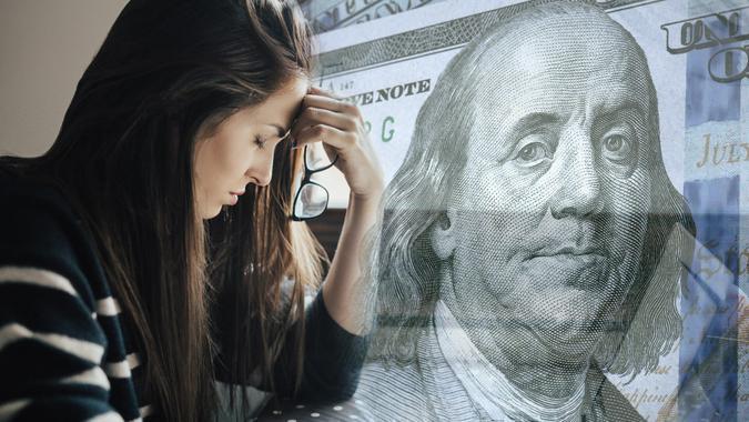 sad millennial struggling with student loan debt