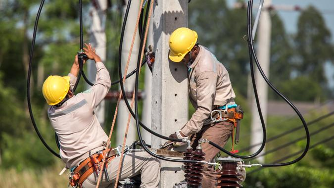 utility workers working on electricity