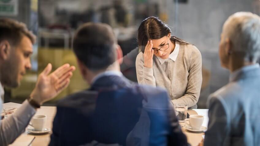 Young woman feeling disappointed after failing on a job interview in the office.