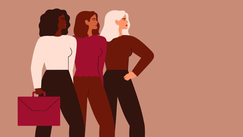 Confident businesswomen stand together.