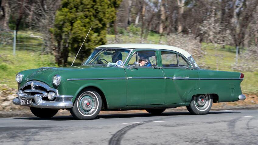Adelaide, Australia - September 25, 2016: Vintage 1954 Packard Clipper Sedan driving on country roads near the town of Birdwood, South Australia.