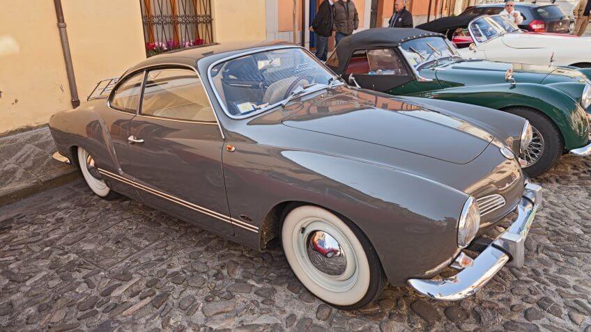 "PREDAPPIO ALTA, FC, ITALY - APRIL 12: vintage German car Volkswagen Karmann Ghia Type 14 (1963) in classic car rally ""Passeggiata turistica primaverile"" on April 12, 2015 in Predappio Alta, FC, Italy."