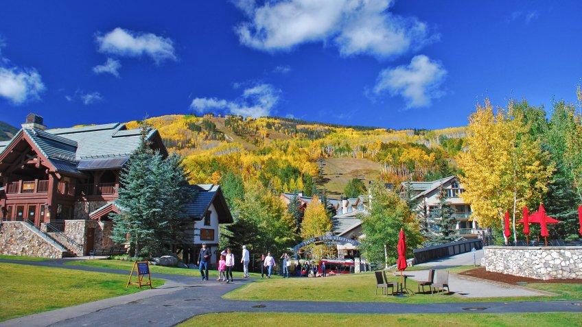 AVON, CO - SEPTEMBER 25, 2016: Families soak in the fall colors at Beaver Creek Resort in Colorado.