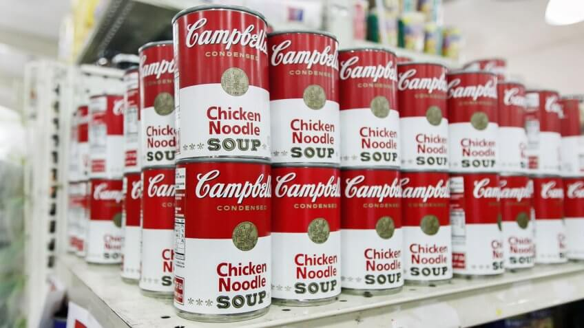 Cans of Campbell's Chicken Noodle Soup on grocery shelf