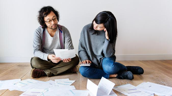 Couple managing the debt.