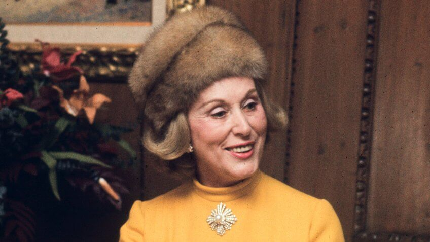 Photo by Tony Palmieri/Penske Media/REX/Shutterstock Estee Lauder wearing a yellow dress and fur hat, introducing a fragrance in her home Estee Lauder at Home, New York