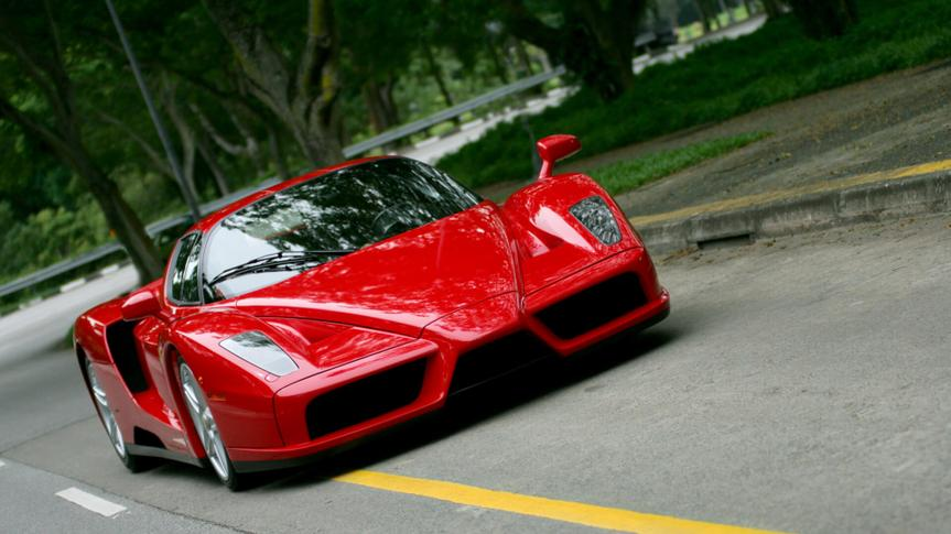 Red Ferrari Enzo on the road in Singapore.