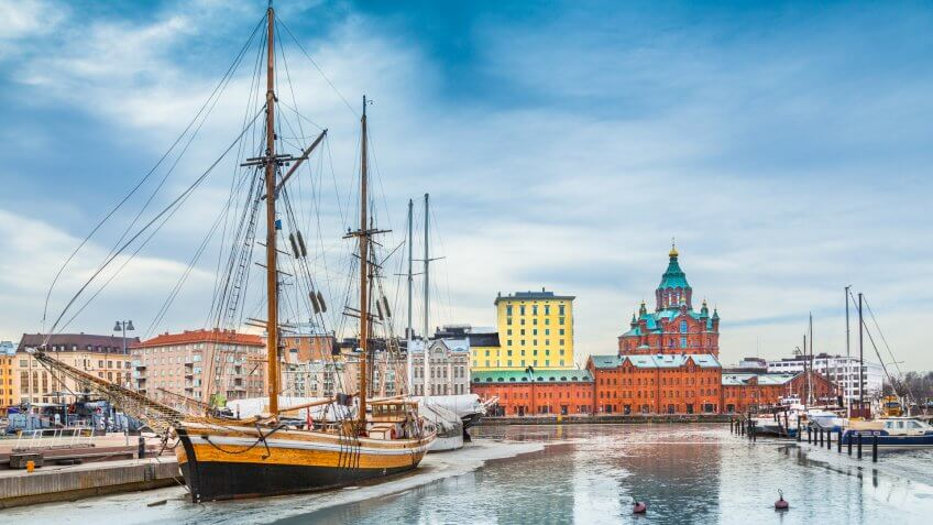 Beautiful view of the old town of Helsinki with famous Uspenski eastern orthodox cathedral church and old port in Katajanokka district of Helsinki on a cold day in winter, Finland.