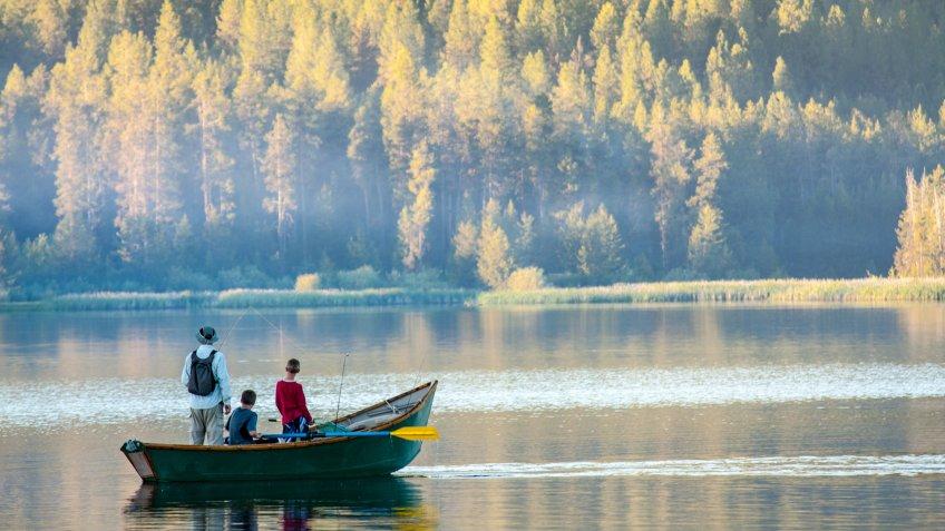 Dad and sons fishing on an Idaho lake - Image.