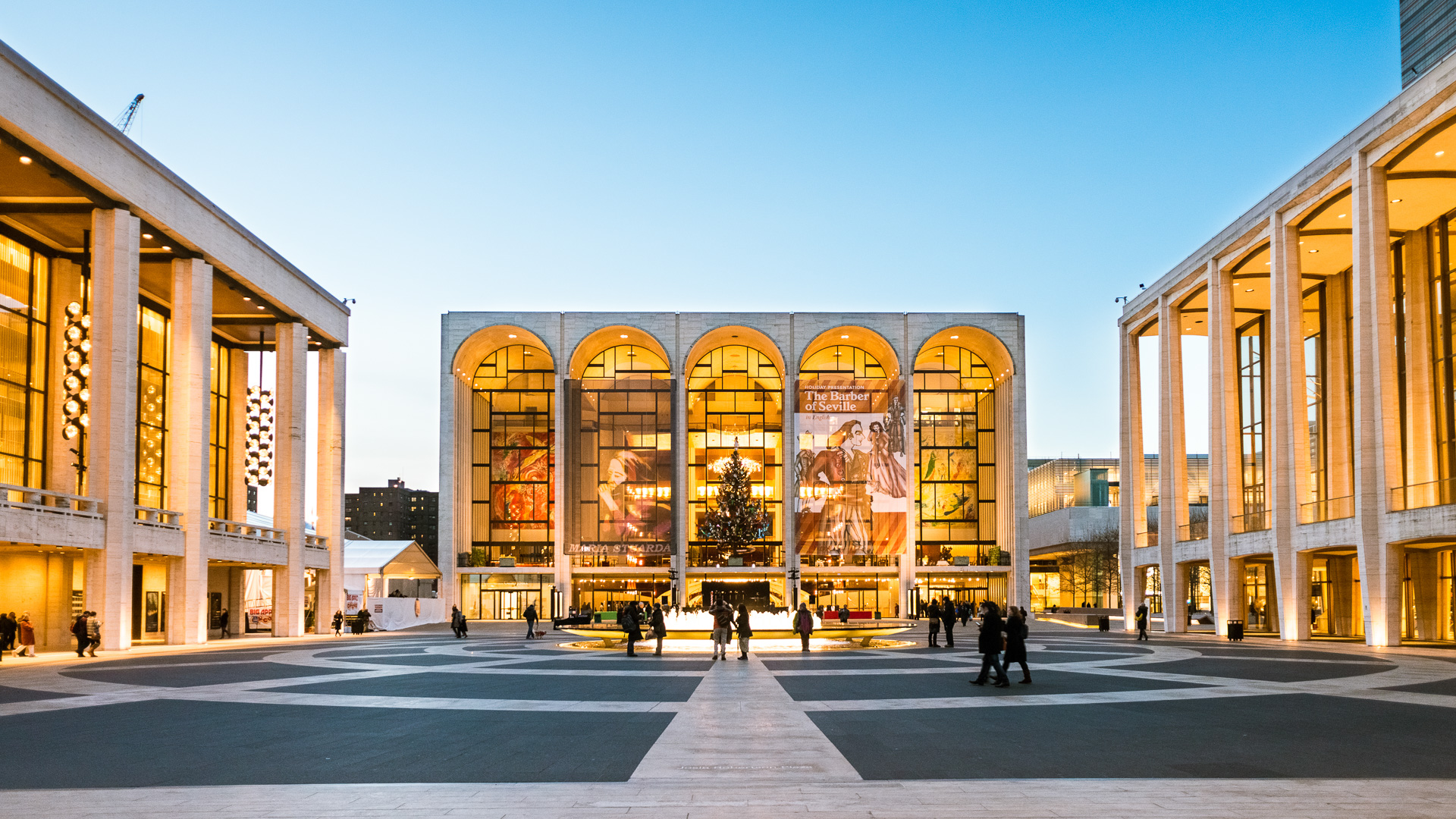"""New York, United States - December 6, 2012: People going to the opera The Barber of Seville at The Lincoln Center, one of the world's leading venue presenting superb artistic programming such as theate, concerts, dance, cinema and poetry."