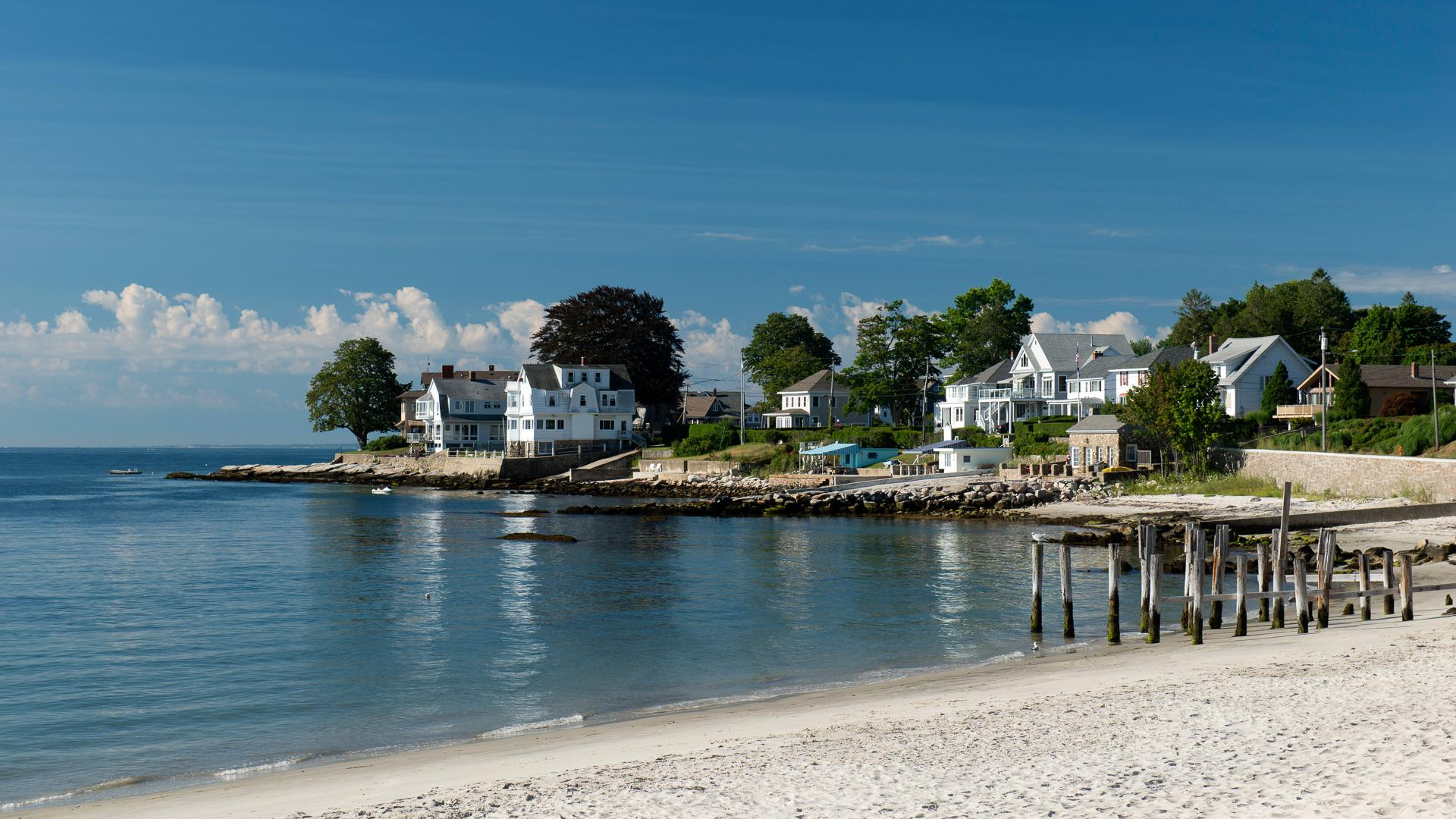 Waterfront houses with scenic harbor view in New London, Connecticut.