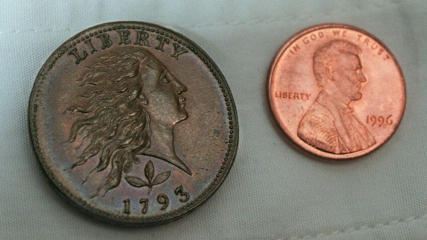 Original Flowing hair cent penny from 1793 with new US Penny