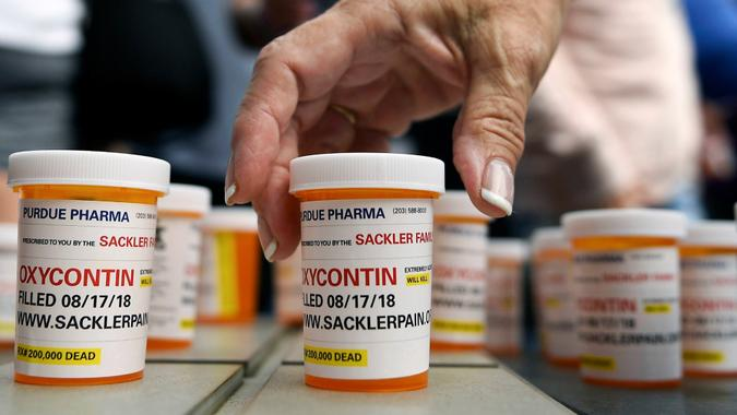 Photo by Jessica Hill/AP/REX/Shutterstock Family and friends who have lost loved ones to OxyContin and opioid overdoses leave pill bottles in protest outside the headquarters of Purdue Pharma, which is owned by the Sackler family, in Stamford, Conn. The Sackler family's ties to OxyContin and the painkiller's role in the deadly opioid crisis are bringing the Sacklers a new kind of attention and complicating their philanthropic legacy Opioid Crisis Philanthropy, Stamford, USA - 17 Aug 2018