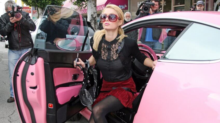 Paris Hilton and her pink Bentley GT Continental automobile