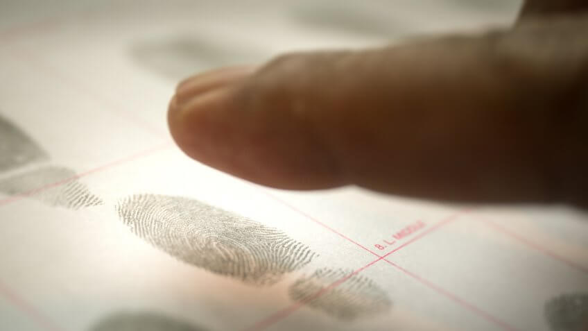 physiological biometrics concept of criminal record by suspect fingerprint for forensic science database with cinematic tone.