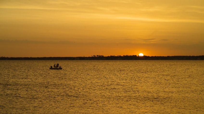 Sunset and boat over Lake Conroe in Texas