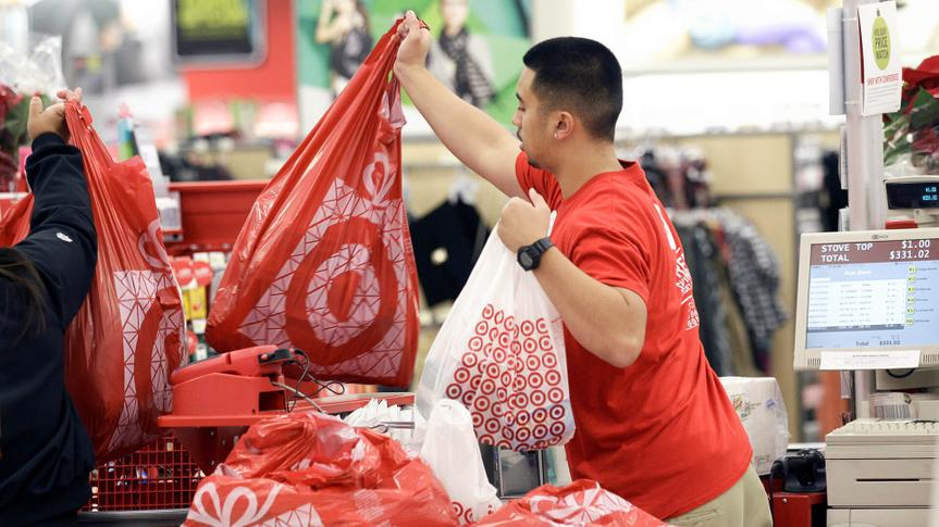 Photo by Jeff Chiu/AP/REX/Shutterstock Target A Target employee hands bags to a customer at the register at a Target store in Colma, Calif. Target executives on said the company is handing out free Fitbit activity trackers to its more than 300,000 employees as the retailer tries to portray itself as a healthier place for both customers and workers Target Wellness, Colma, USA