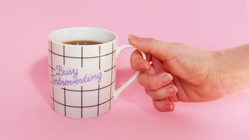 a mug with the words busy introverting inscribed on it